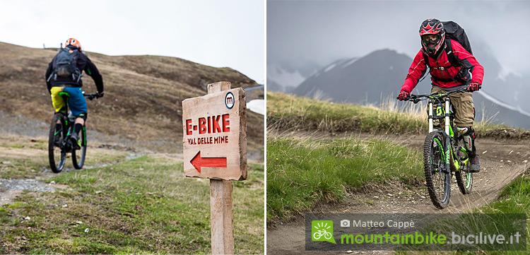 foto di due biker su una bici elettrica e una da downhill al bike park mottolino