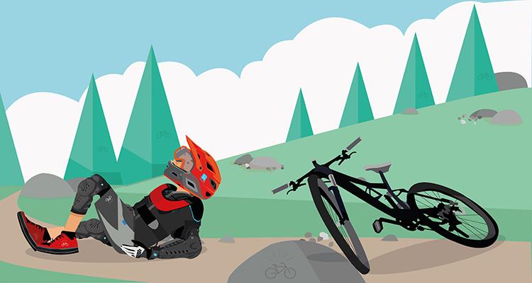 biker con il casco a terra dopo una caduta