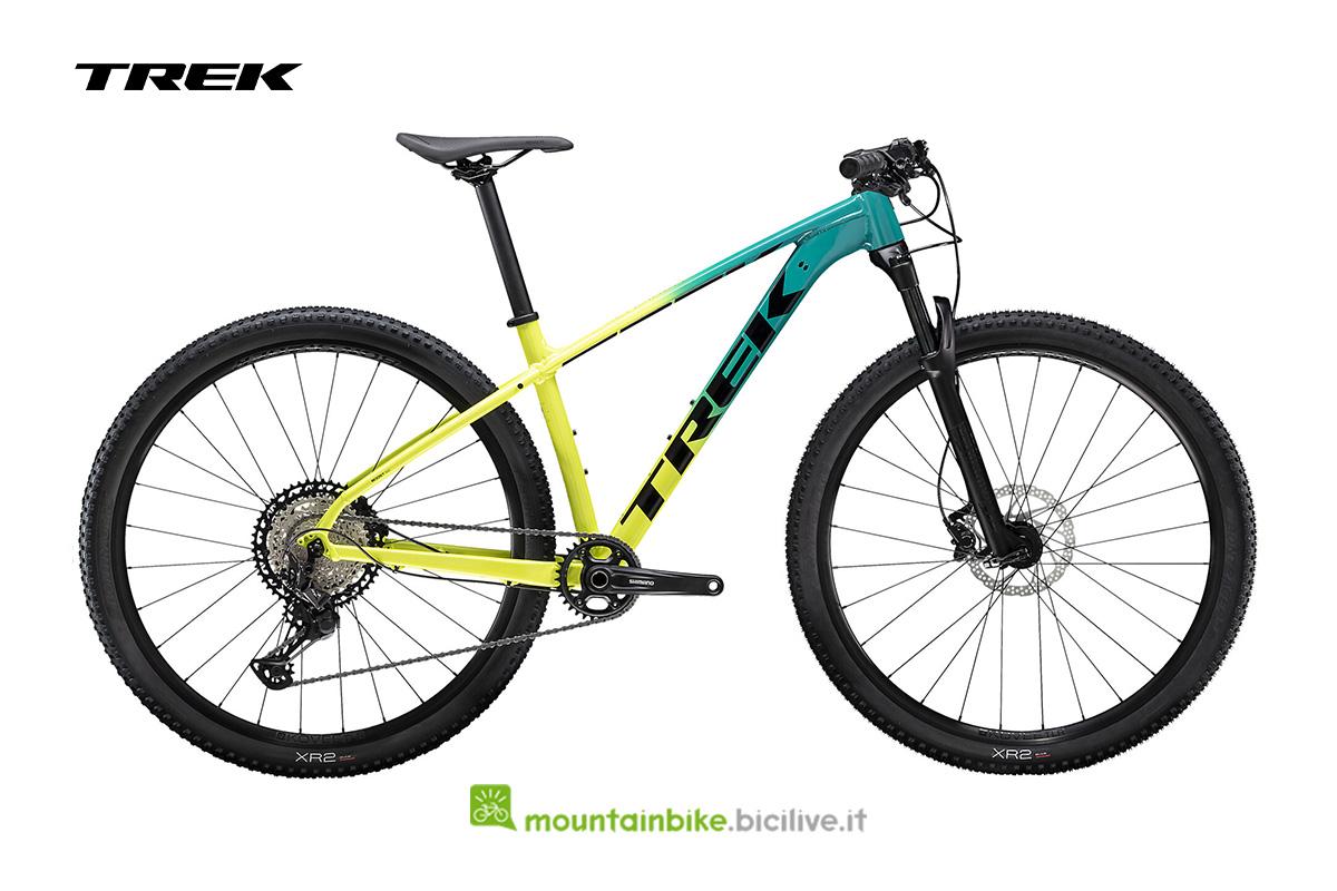 bici X-Caliber 9 vista di lato gialla/verde con logo nero