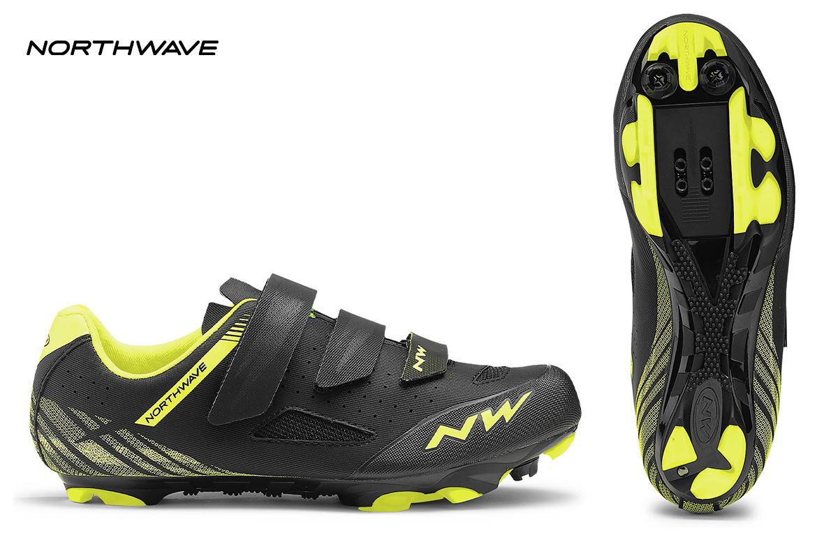 una scarpa Northwave Origin gialla e nera di profilo con visuale della suola